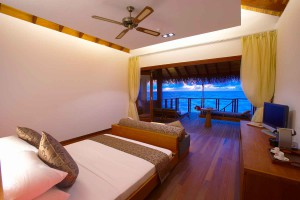 Medhufushi Water Villa bedroom