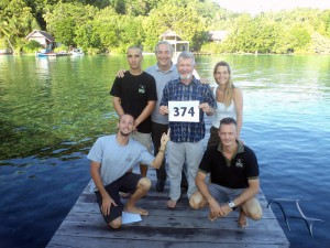 Dr. Gerald Allen and the Papua Diving team celebrate his record breaking dive!